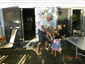 On the porch in Michigan, Dad grabs my farm princess for a few spins. She loves to dance; it runs in her blood just like farming.
