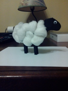 "We crafted this sheep using black cardstock instead of white and used a ""google"" eye instead of drawing one on the face.  The clothespins were also painted black, but could be colored with a black permanent marker."