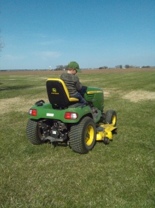 Not many things will keep the farm boy out of the field, but mowing lawn seems to be better than planting corn for him.
