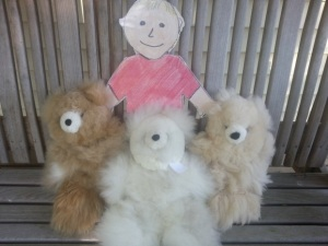 Figure 3. Aggie with teddy bears made from alpaca fiber.