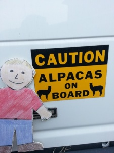 Figure 9. Aggie next to the sign on the van.